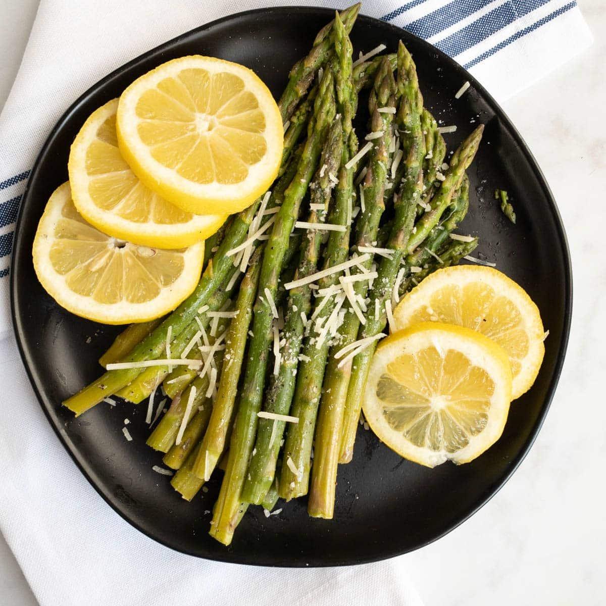 Instant Pot Asparagus on a plate with lemon